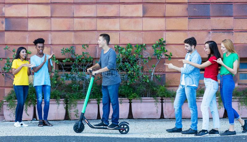 Hipster man driving electric scooter royalty free stock images