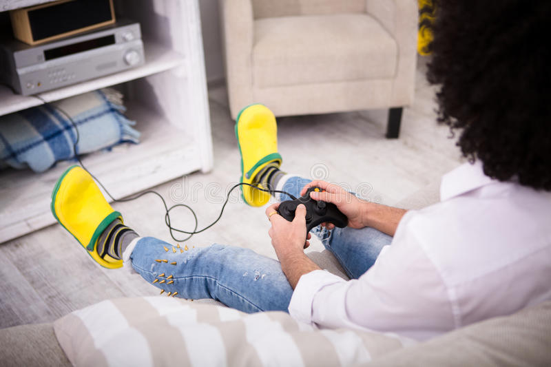 Hipster man playing computer games royalty free stock images