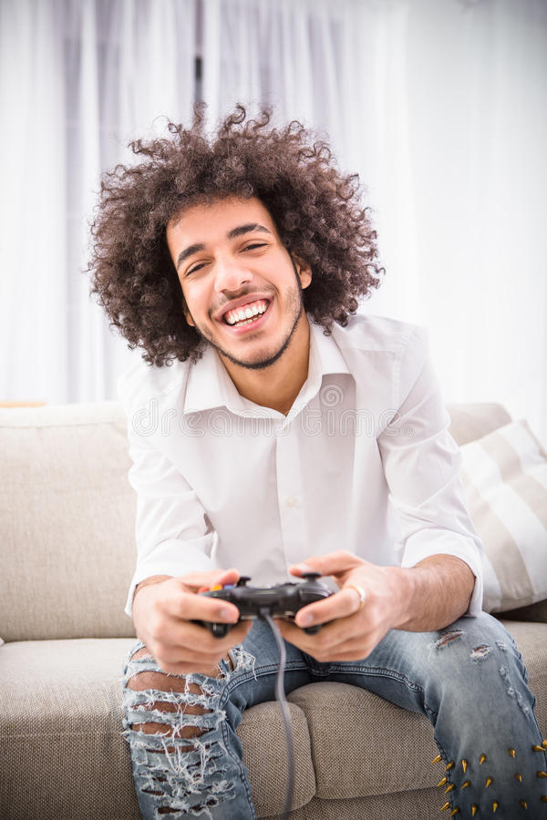 Hipster man playing computer games royalty free stock image