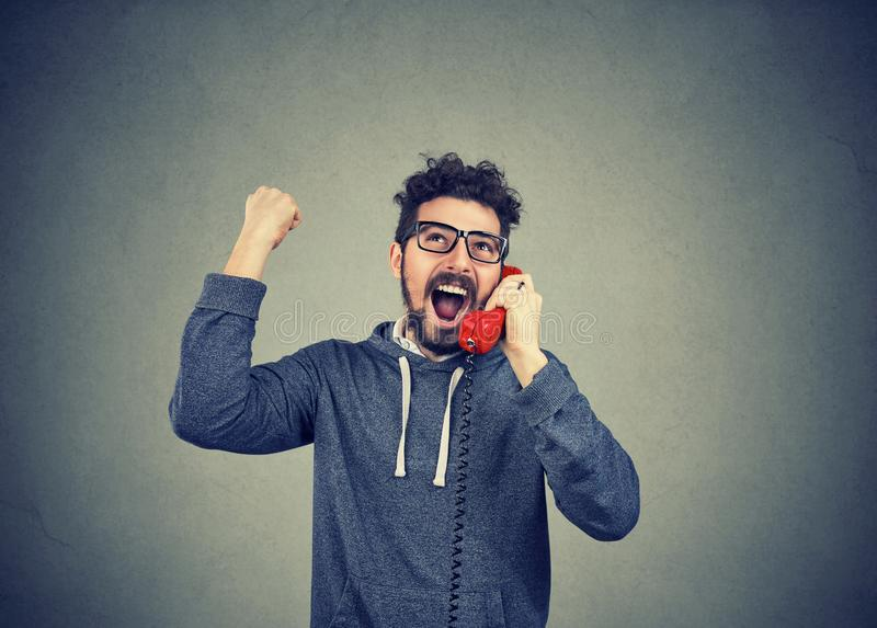 Hipster man receiving great news by phone feeling excited stock photos