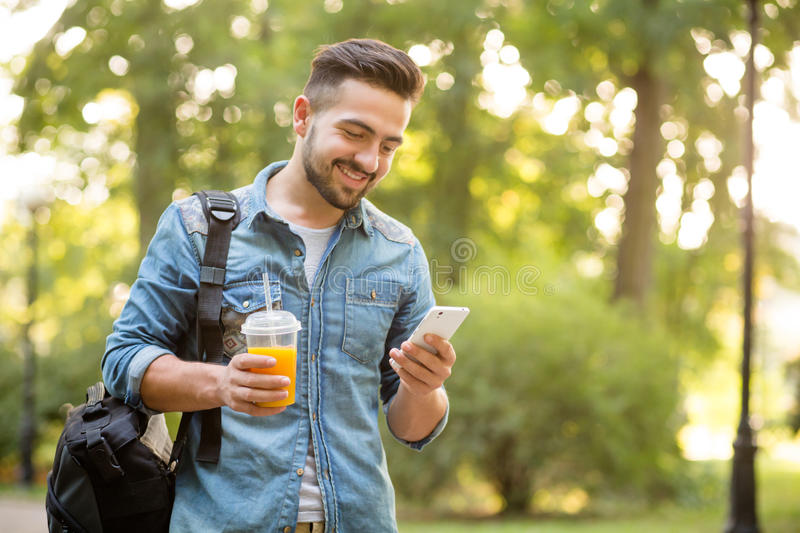 Hipster man walking in autumn park stock photos