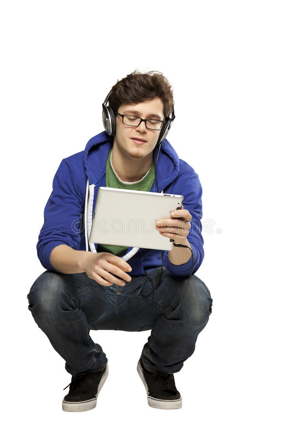 Hipster man watching video on Ipad royalty free stock photo