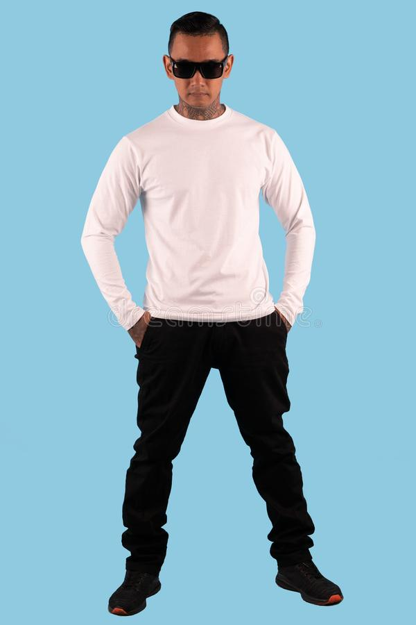 Hipster man with wearing white long sleeve t shirt ready for your mock up template or background. Black man royalty free stock photography