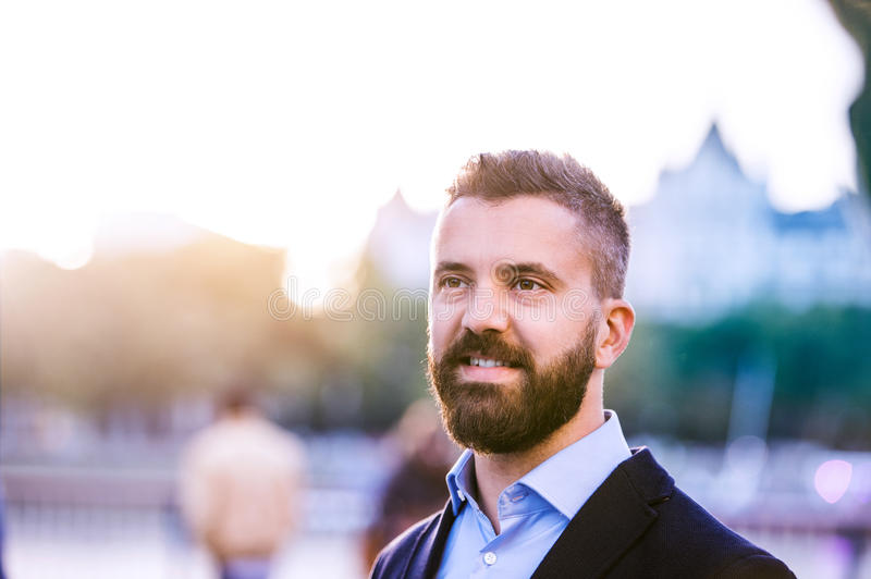 Hipster manager in blue shirt walking in the street royalty free stock photos