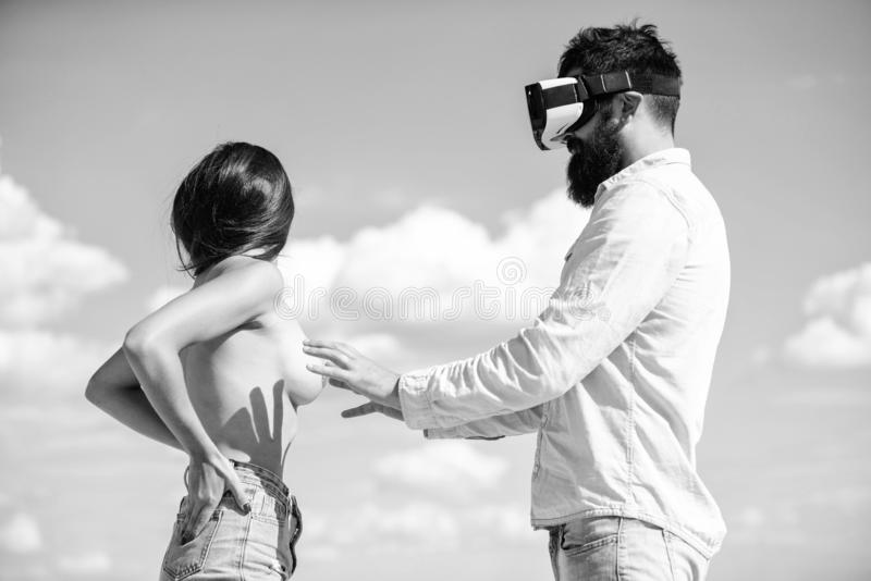 Hipster man play virtual sex game hmd or vr glasses. Virtual sexual activity. Man touch naked erotic breasts. Hipster men play virtual sex game hmd or vr glasses royalty free stock image