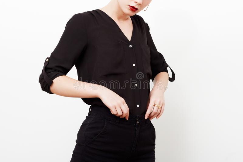 Hipster Model. Swag. Minimal style. Vintage Glamour. Fashionable model in a trendy silk shirt and black pants. Outfit stock images