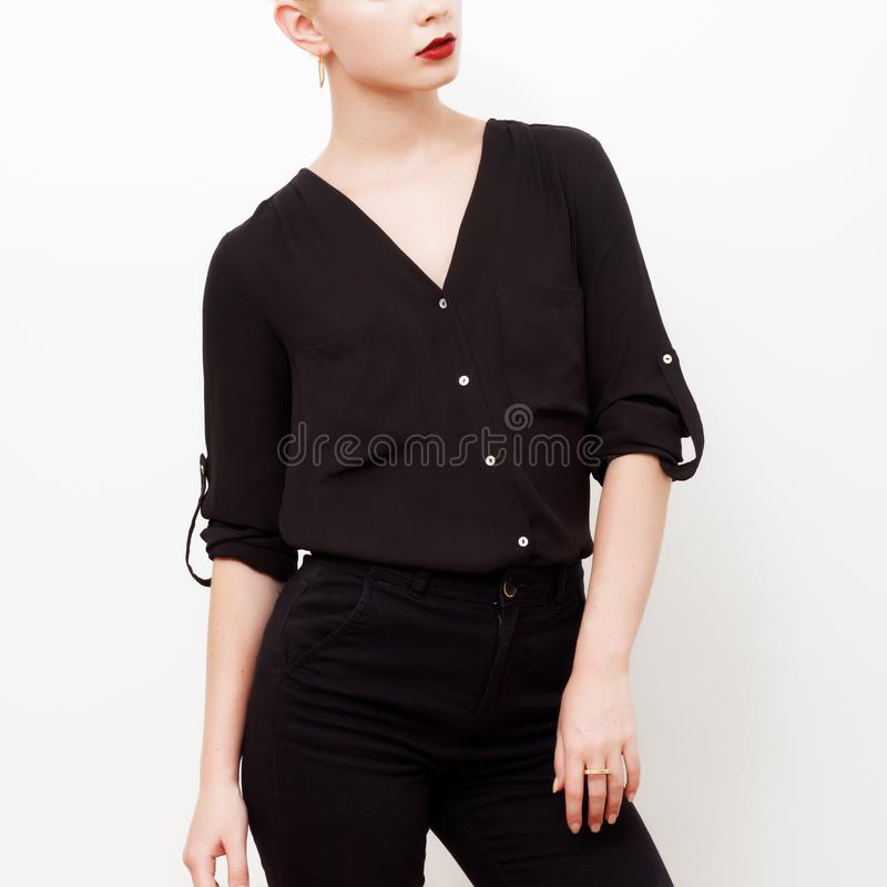 Hipster Model. Swag. Minimal style. Vintage Glamour. Fashionable model in a trendy silk shirt and black pants. Outfit stock photos
