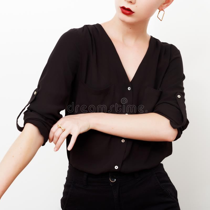 Hipster Model. Swag. Minimal style. Vintage Glamour. Fashionable model in a trendy silk shirt and black pants. Outfit royalty free stock photo