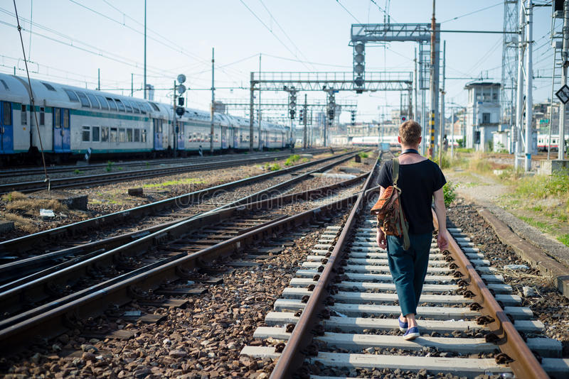 Hipster modern stylish blonde man on rails. In daily life stock photography