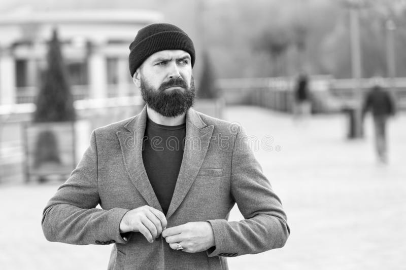 Hipster outfit and hat accessory. Stylish casual outfit spring season. Menswear and male fashion concept. Man bearded. Hipster stylish fashionable coat and hat stock photography