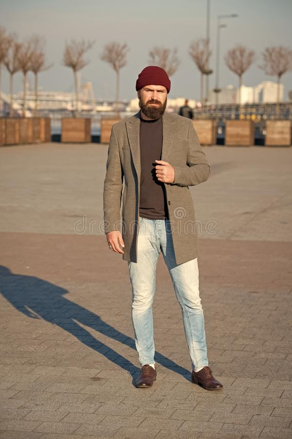 Hipster outfit. Stylish casual outfit for fall and winter season. Menswear and male fashion concept. Man bearded hipster. Stylish fashionable coat. Comfortable royalty free stock image