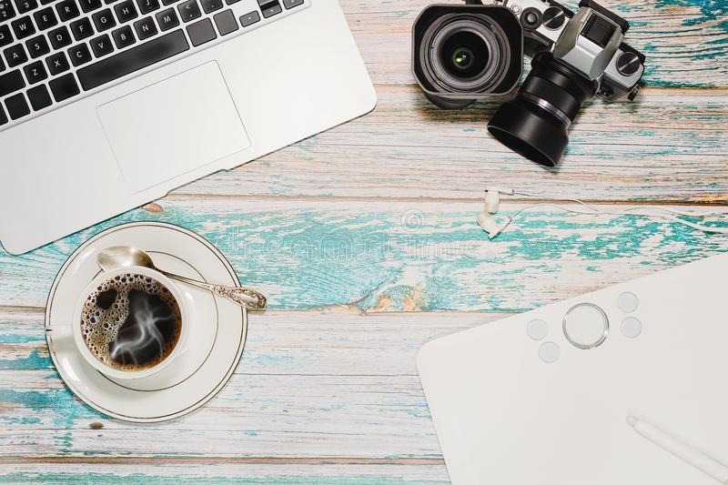 Hipster photographer and blogger workspace stock photos