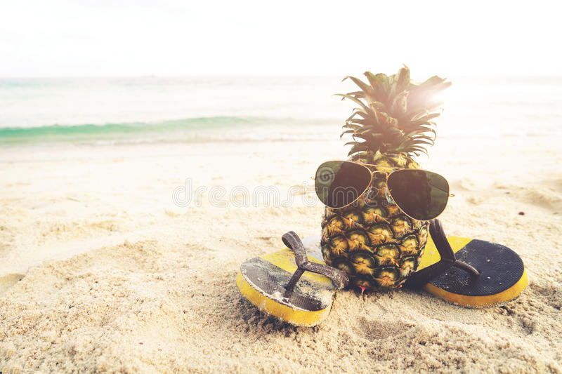 Hipster pineapple on beach - fashion in summer. Vintage filter effect stock photos
