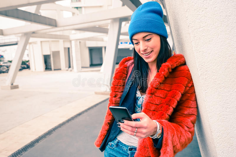 Hipster portrait of happy young woman with smartphone royalty free stock photo