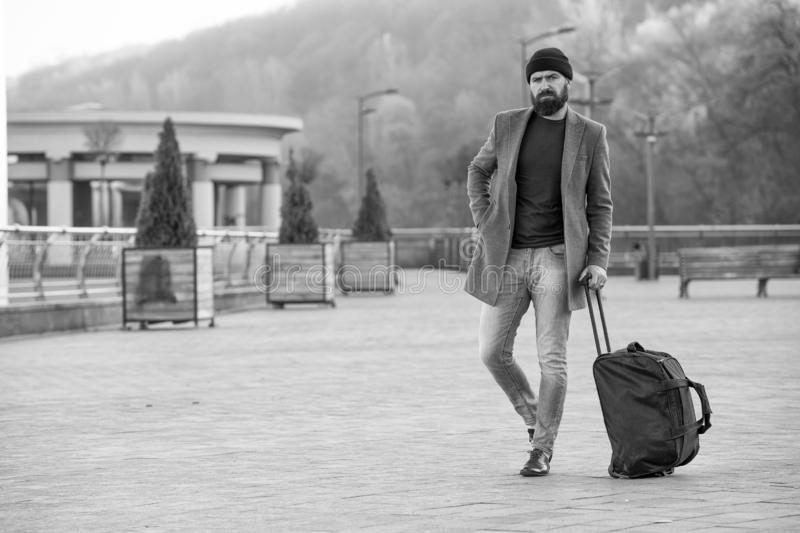 Hipster ready enjoy travel. Looking for accommodation. Man bearded hipster travel with big luggage bag wait for taxi. Bring him to hotel. Travel tips. Traveler stock images