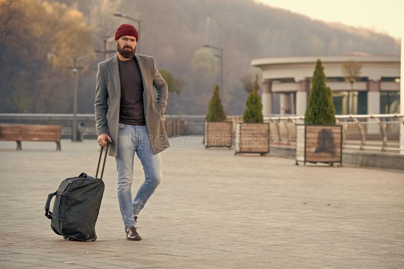 Hipster ready enjoy travel. Looking for accommodation. Man bearded hipster travel with big luggage bag wait for taxi. Bring him to hotel. Travel tips. Traveler royalty free stock photos