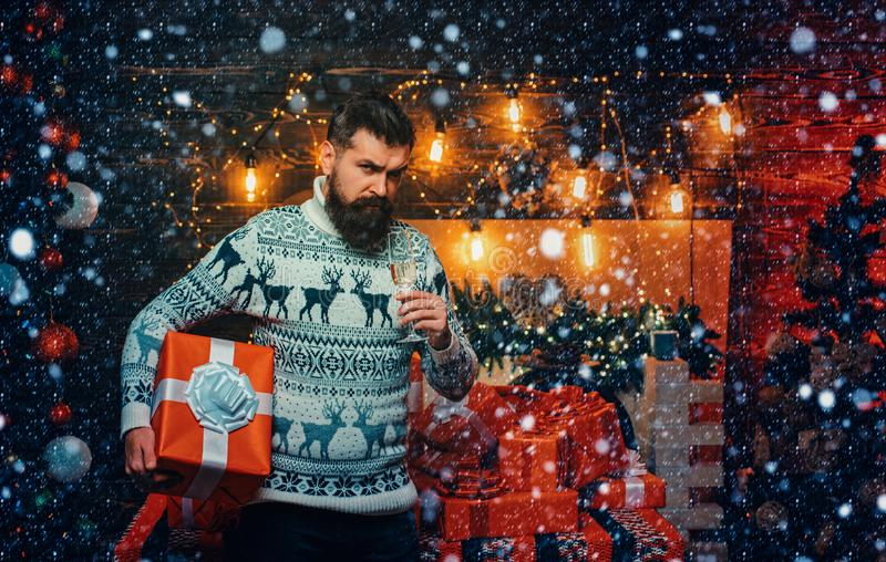 Hipster santa claus. Santa Claus gifting gift. Bearded man in Christmas sweater. Thanksgiving day and Christmas. Gift royalty free stock photography
