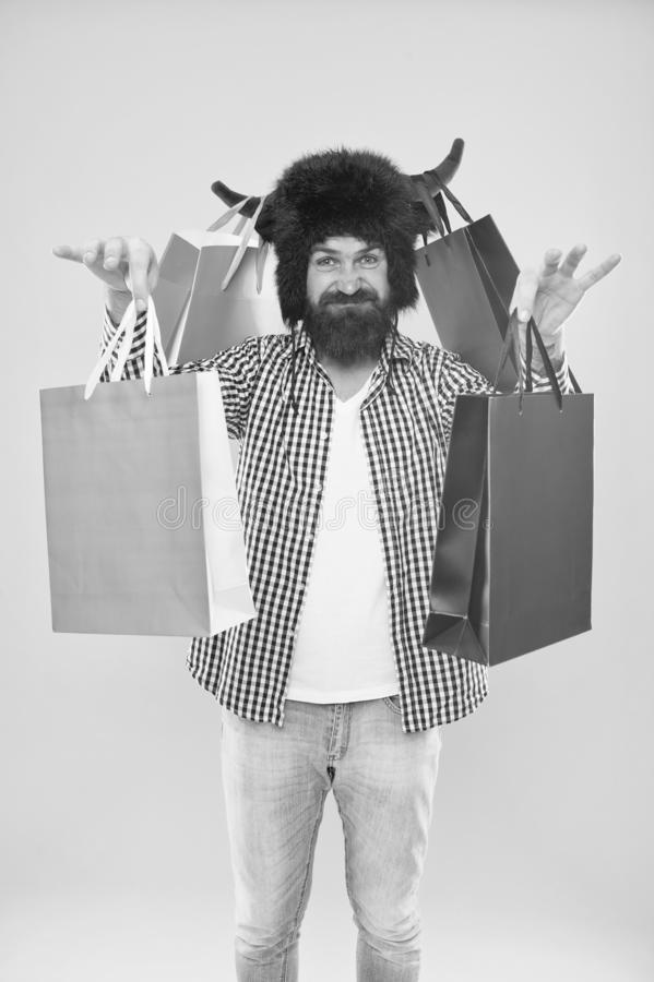 Hipster shopping addicted or shopaholic. Shopping concept. Guy shopping sales season discount. Animal and vet store. Wild about shopping. Full packages of royalty free stock photography
