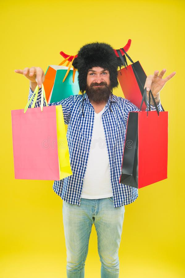 Hipster shopping addicted or shopaholic. Shopping concept. Guy shopping sales season discount. Animal and vet store. Wild about shopping. Full packages of royalty free stock photo