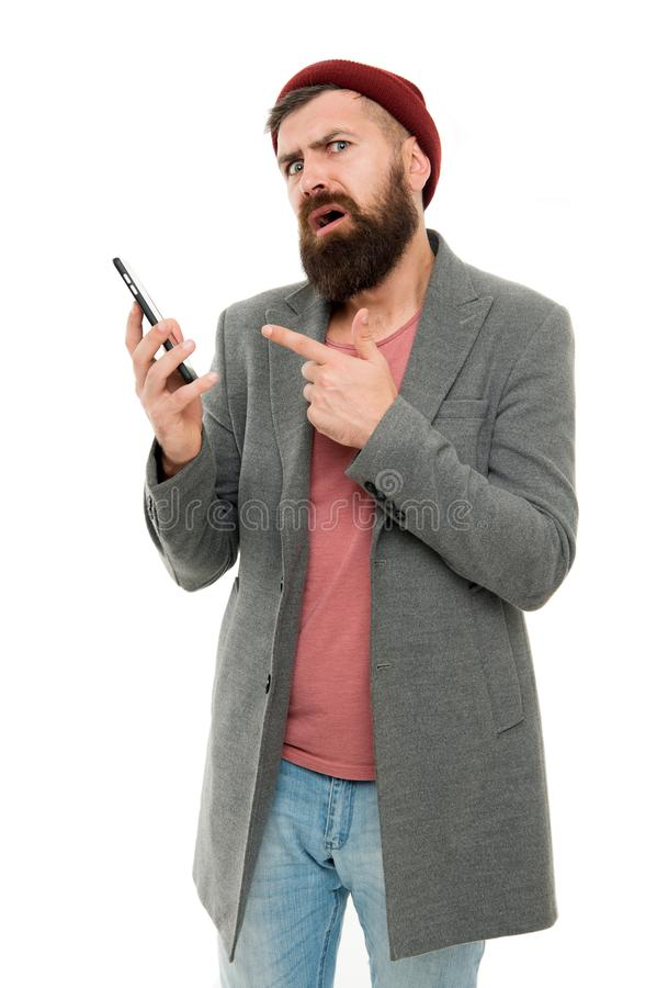 Hipster smartphone call friend. Mobile call concept. Important conversation. Man bearded hipster hold mobile phone white. Background. Stylish guy use mobile stock images