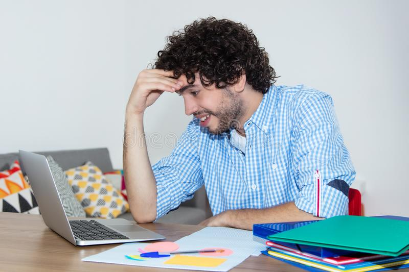 Hipster student working at computer royalty free stock image