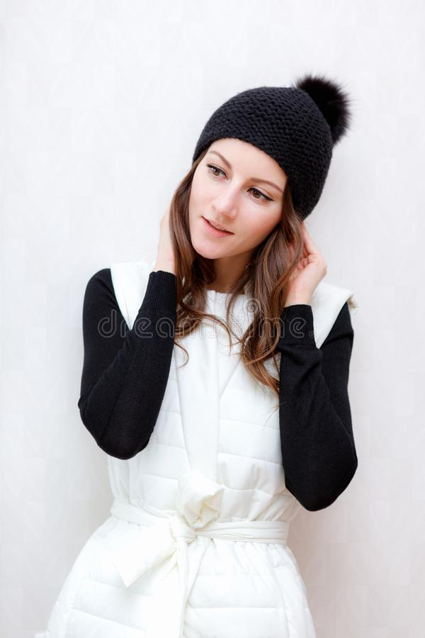 Free Hipster Style Brunette Girl Swag Wearing Black Fashion Beanie Knitted Hat With Bumbon Pumpon. Season Fall Winter Stock Photo - 119033100