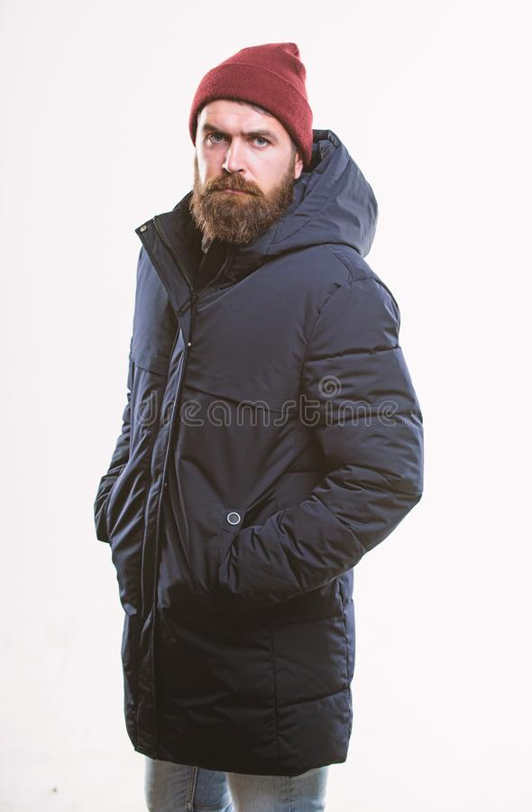 Hipster style menswear. Hipster outfit. Man bearded hipster posing confidently in warm black jacket or parka. Stylish. And comfortable. Hipster modern fashion royalty free stock photography