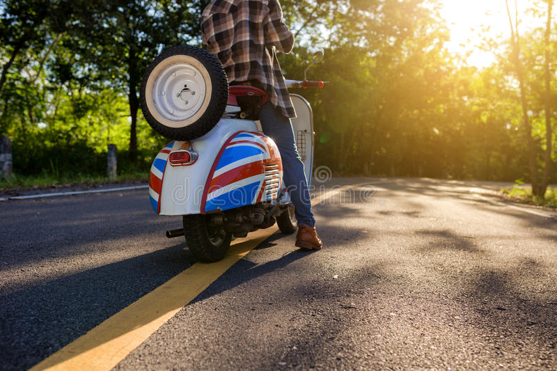 Hipster style person tour by motorcycle on the center road and y royalty free stock photos