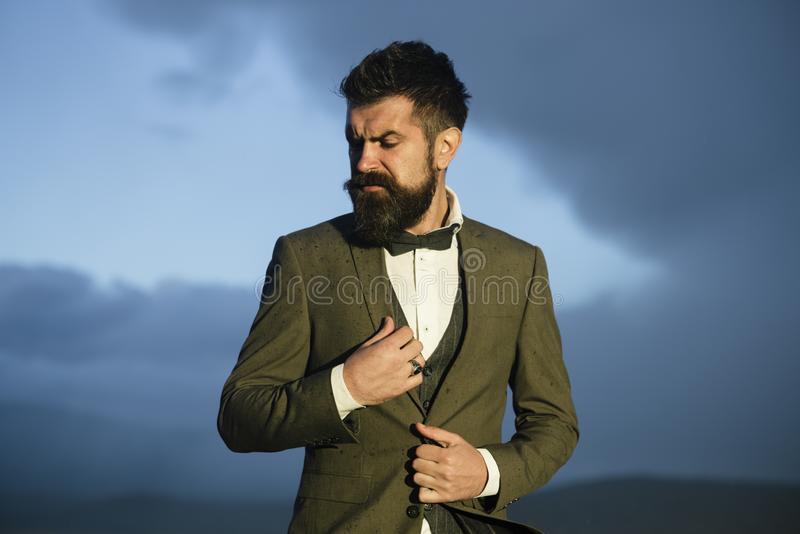 Hipster with stylish appearance in front of dramatic sky, skyline. stock photography