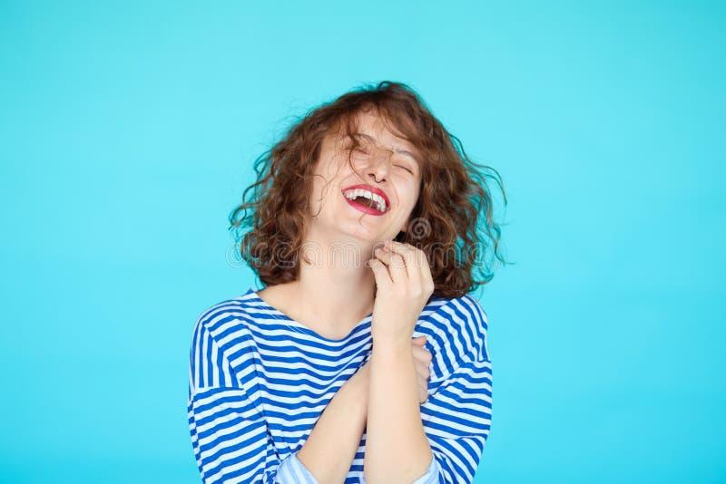 Hipster teenage girl against blue color background stock images