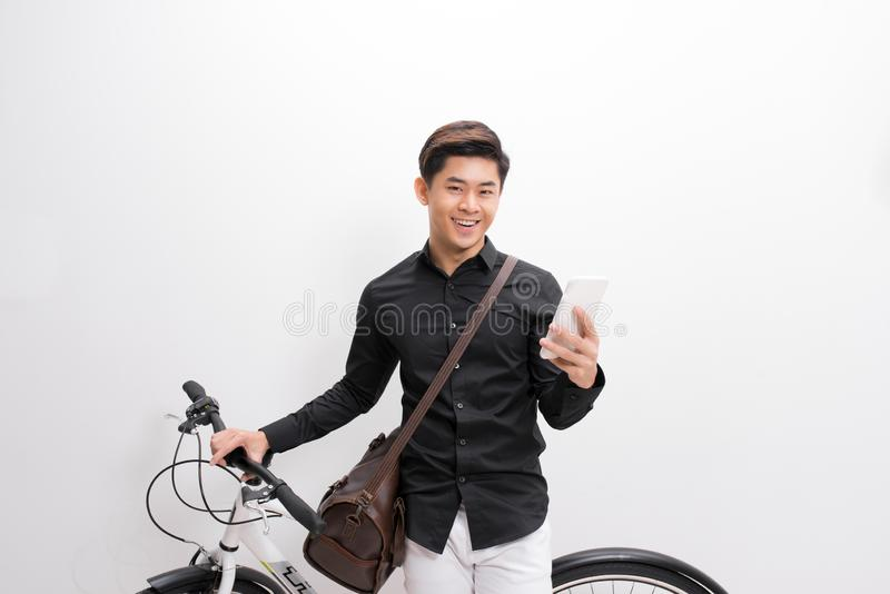 Hipster texting someone on his bike royalty free stock images