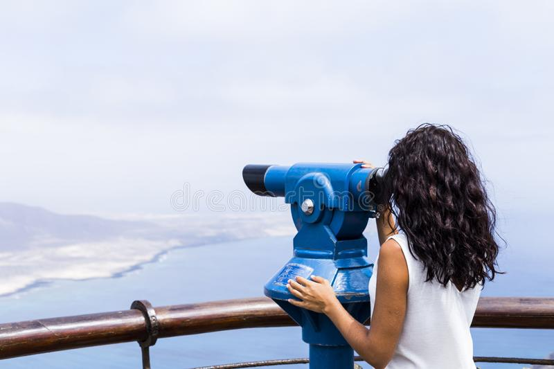 Hipster tourist look observant binoculars telescope on panoramic view, lifestyle concept trip, traveler on background mountain and. Blue sea landscape horizon stock photo