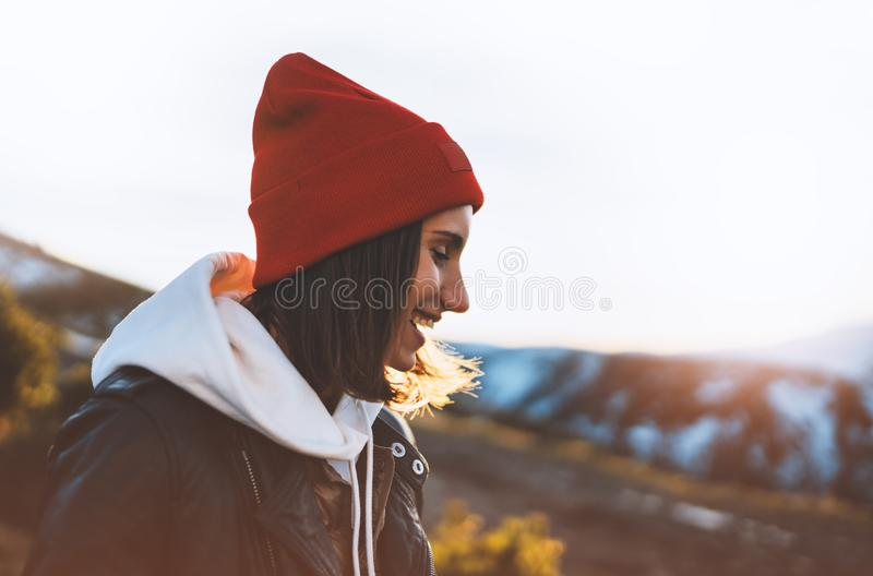 Hipster tourist smile and happy on background sun flare nature, young girl laugh enjoy journey landscape vacation trip, lifestyle royalty free stock photography