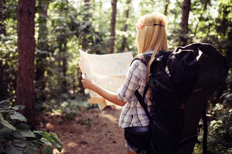 Hipster tourist woman with map hiking, lifestyle adventure concept. Hipster tourist woman with map hiking, lifestyle concept adventure, traveler with backpack royalty free stock photography