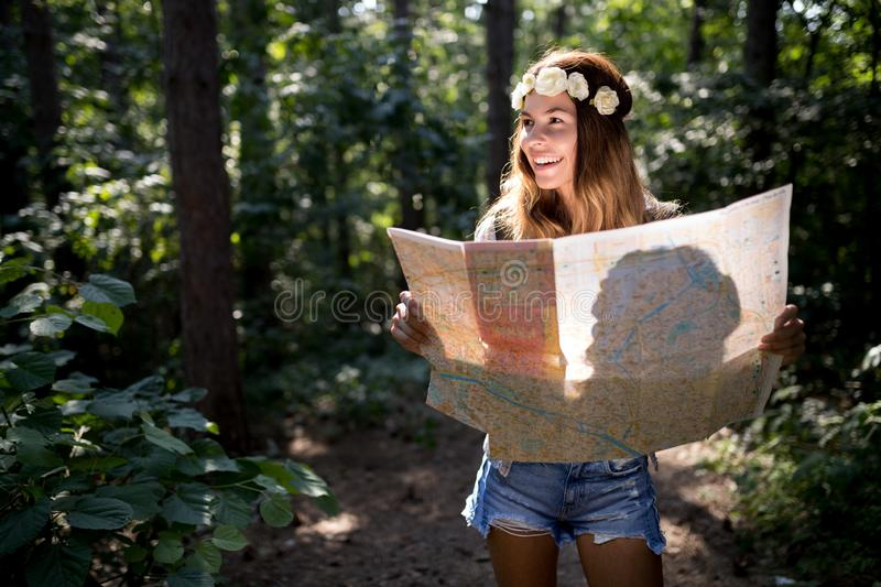 Hipster tourist woman with map hiking, lifestyle adventure concept stock photos