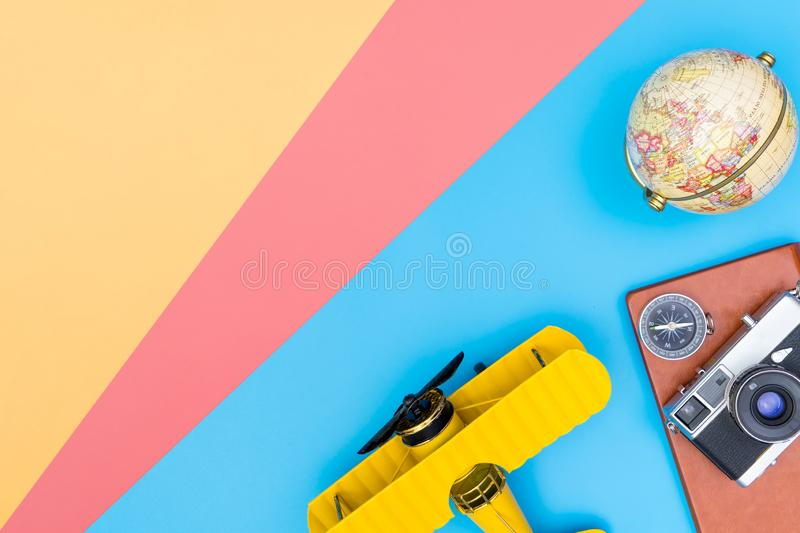Hipster travel blogger accessories flatlay on blue yellow. Hipster travel blogger writer accessories flatlay on blue yellow and pink royalty free stock photo