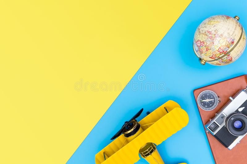 Hipster travel blogger accessories flatlay on blue yellow and pink. Hipster travel blogger writer accessories flatlay on blue yellow and pink stock image