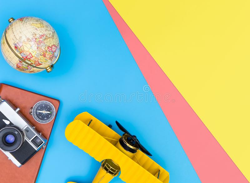 Travel blogger writer accessories flatlay on blue yellow and pink. Hipster travel blogger writer accessories flatlay on blue yellow and pink royalty free stock image