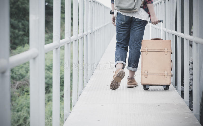 Hipster travel woman drag vintage luggage on bridge. Hipster traveler woman drag vintage luggage on bridge with film tone, concept travel and journey on holiday stock images