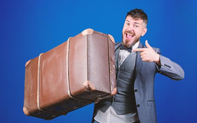 Hipster traveler with baggage. Baggage insurance. Man well groomed bearded hipster with big suitcase. Take all your royalty free stock images