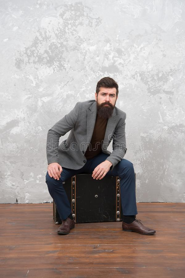 Hipster traveler with baggage. Ready for relocation with baggage. Start journey. On way to new life. Man well groomed stock photo