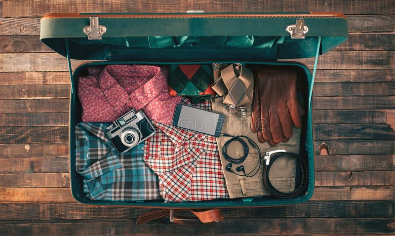 Hipster traveler packing stock images
