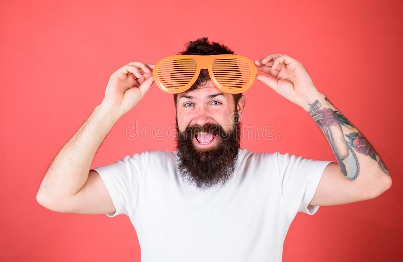Hipster wear shutter shades sunglasses. Party festive accessory. Sunglasses party attribute and stylish accessory. Party. Detail accessory concept. Man bearded royalty free stock photos