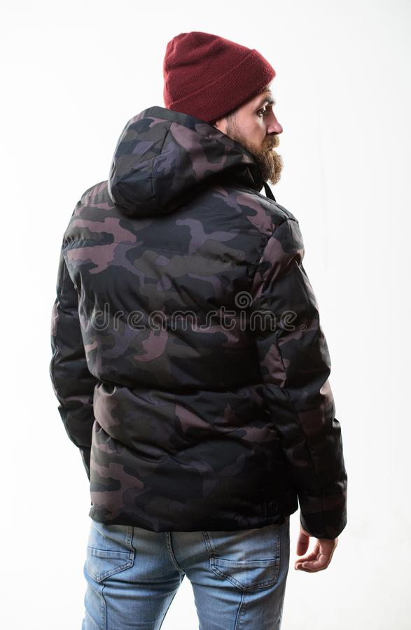 Hipster winter fashion. Guy wear hat and black winter jacket. Comfortable winter outfit. Winter stylish menswear. Man royalty free stock photo