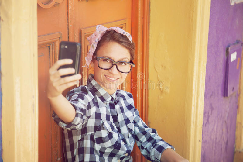 Hipster woman with cel phone royalty free stock images