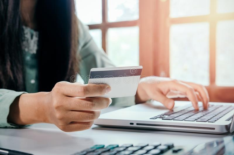 Hipster woman hands holding laptop. And using credit card for online shopping.Online shopping concept stock image