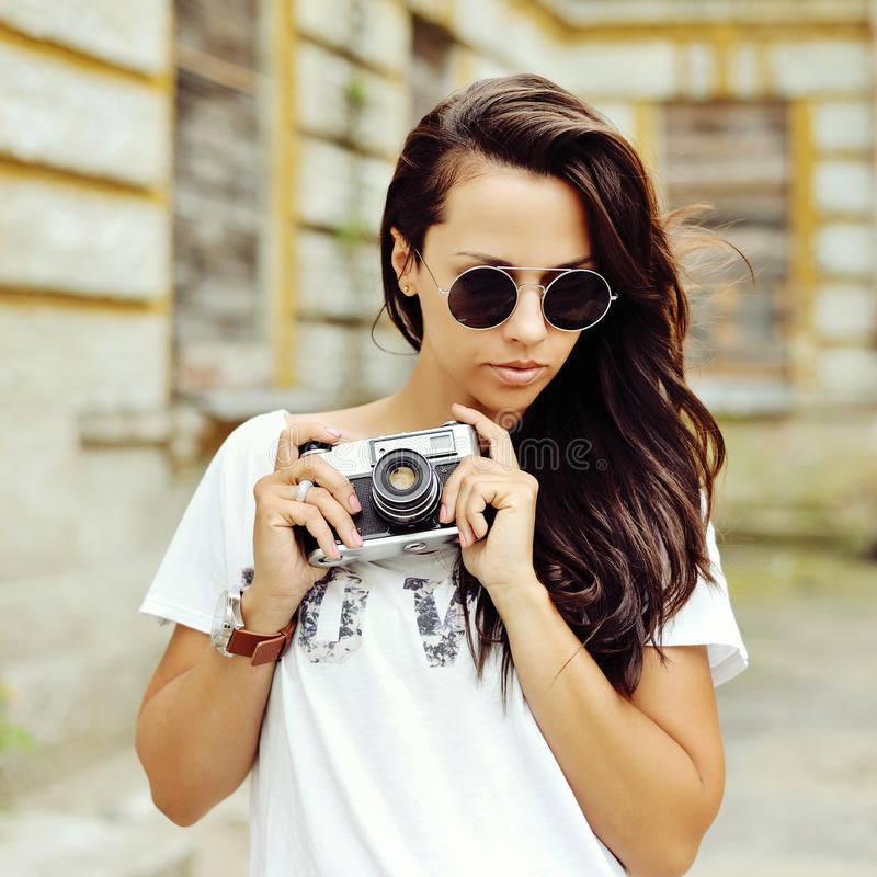 Hipster woman with retro film camera outdoor fashion portrait.  royalty free stock photo