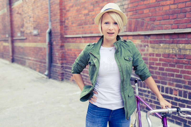 Hipster woman with vintage road bike in city. Hipster cyclist young beautiful girl with vintage road bike on city street, urban scene. Commuting to work concept royalty free stock images