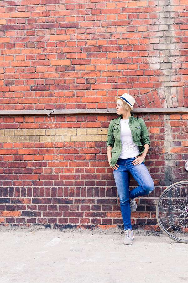 Hipster woman with vintage road bike in city. Hipster young beautiful girl with vintage road bike in city, urban scene. Woman cycling on fixed gear bike in town royalty free stock image