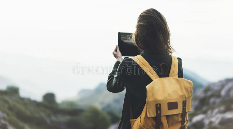 Hipster young girl with bright backpack enjoying sunset on peak of foggy mountain. Tourist traveler on background valley landscape. View mockup. Hiker stock photos